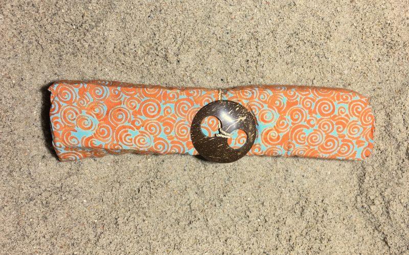 1-1009 Pareo Canggu: pudriges orange Spiralen in türkis