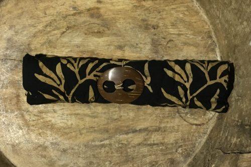 1-9005-1 Dukuh schwarz mit Blätterzweige in braun-ocker